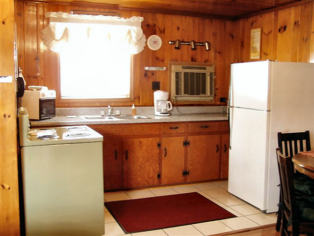 1 Bed Kitchenette: full kitchen, refrigerator, stove, coffee maker, microwave, dishes, pots and pans.