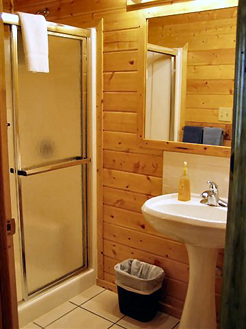 2 Bedroom Cabin: Bath has toilet, sink and tub/shower combination, half bath with sink and shower.