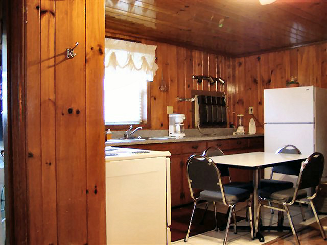 2 Bed Kitchenette: full kitchen, refrigerator, stove, coffee maker, microwave, dishes, pots and pans.
