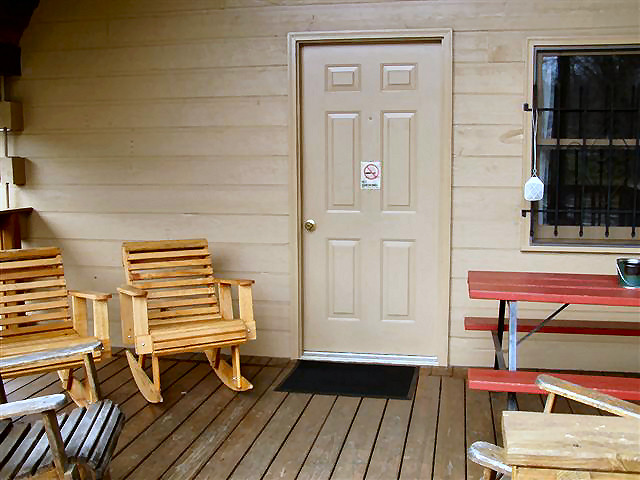 Big Cabin: Deck with picnic table and rocking chairs.