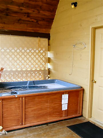 Cabin Hot Tub: Deck with rocking chairs and hot tub, semi-privacy deck. (ADULTS ONLY)