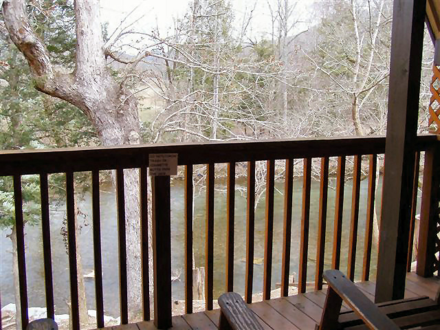 River Cabin: Deck over looks river with picnic table and rocking chairs. (ADULTS ONLY)